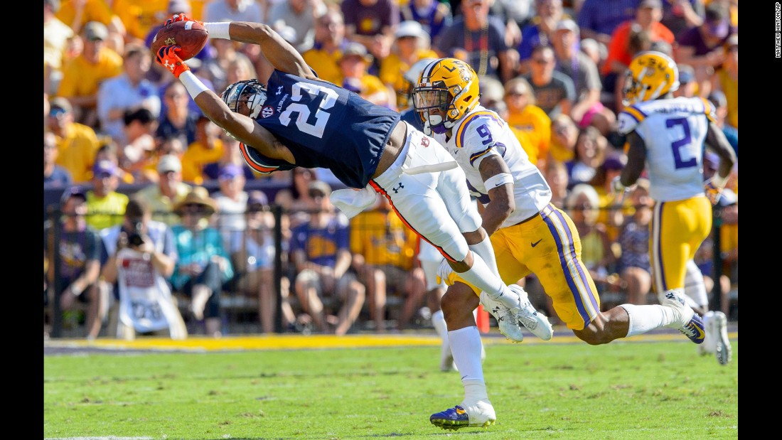 Auburn wide receiver Ryan Davis stretches for a catch against LSU safety Grant Delpit in the first half of an NCAA college football game on Saturday, October 14, in Baton Rouge, Louisiana.