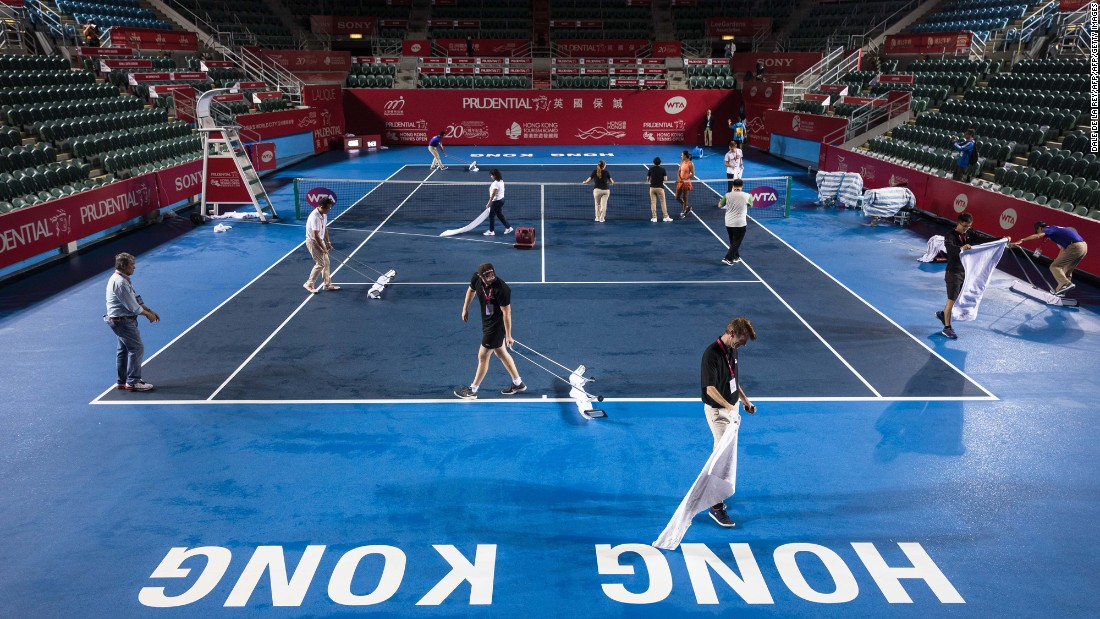 "Workers and officials dry the court after heavy rain from Typhoon Khanun, which delayed the start of the women's singles final between Russia's Anastasia Pavlyuchenkova and Australia's Daria Gavrilova at the Hong Kong Open tennis tournament on Sunday, October 15. <a href=""http://www.cnn.com/2017/10/09/sport/gallery/what-a-shot-sports-1010/index.html"" target=""_blank"">See 35 amazing sports photos from last week</a>"