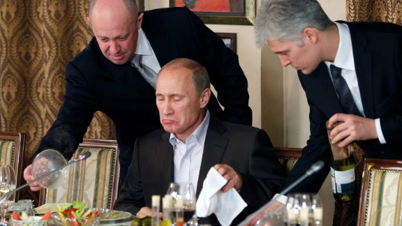 Russian Prime Minister Vladimir Putin sits during a dinner with foreign scholars and journalists at the restaurant Cheval Blanc on the premises of an equestrian complex outside Moscow, Russia, Friday, Nov. 11, 2011. (AP Photo/Misha Japaridze, Pool)