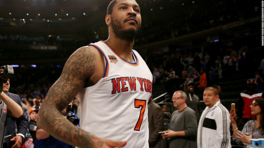NBA star Carmelo Anthony is one of many athletes who sports a sleeve -- a series of tattoos covering his arm. On his right arm is a flaming basketball with his initials, representing his commitment to his sport.