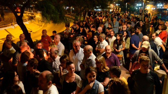 Thousands of people gather for a candlelight vigil in Sliema on October 16, 2017.
