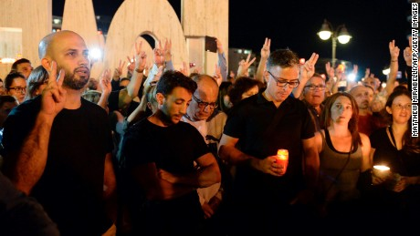 Thousands of people gather for a candlelight vigil in Sliema in tribute to Caruana Galizia on Monday.