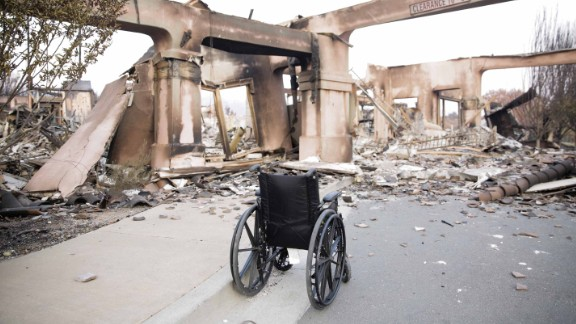 An empty wheelchair sits among the charred remains of a housing development in Santa Rosa, California.