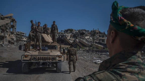 Soldiers of SDF on the top of a humvee during celebration of the liberation of Raqqah.West Raqqah October 17, 2017