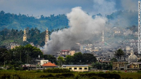 Smoke billows from houses after aerial bombings by Philippine Air Force planes on Islamist militant positions in Marawi on September 17, 2017.