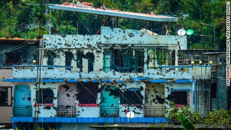Bullet-riddled houses are seen in Marawi on August 28, 2017.