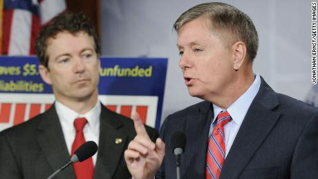Sen. Rand Paul (R-KY) (L) and Sen. Lindsey Graham (R-SC) speak about their Social Security reform plan at the U.S. Capitol on April 13, 2011 in Washington, DC. )