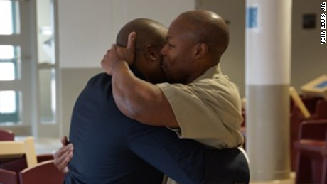 Tony Lewis, Sr, (left) hugs his son during a prison visit in 2016.