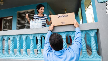 Aguas Buenas Mayor Javier Garcia Perez delivers water as he checks on his community.