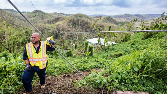 Getting power back to hilltop communities like Aguas Buenas after Hurricane Maria requires work in tough terrain.
