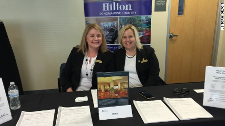 Lenora Olson, left, at a job fair held in 2016