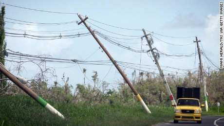 Power lines hang precariously on Saturday, Oct. 14, 2017 on the side of the road on highway 118 near San Isidro, Puerto Rico. (Jose A. Iglesias/Miami Herald/TNS via Getty Images)