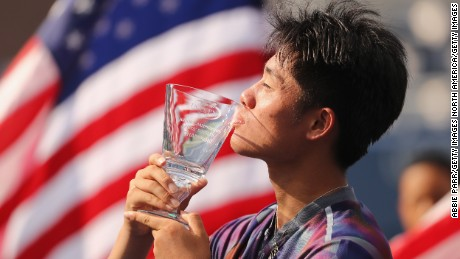 Wu holds the junior boys championship trophy after defeating Axel Geller of Argentina in the US Open