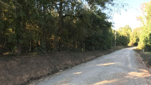 Coggins' body was found in a field off this gravel road in Sunny Side, news reports from the time say.