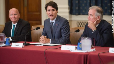 Canadian Prime Minister Justin Trudeau (C) meets with members of the House Committee on Ways and Means, including Committee Chairman Kevin Brady (L), Republican of Texas, and Ranking Member Richard Neal (R), Democrat of Massachusetts, about the NAFTA renegotiations on Capitol Hill in Washington, DC, on October 11, 2017. A fourth round of talks to revamp a landmark North American trade pact begin on October 11, 2017 amid inflamed tensions between Washington and Ottawa over a trade dispute involving Bombardier aircraft. Canadian Prime Minister Justin Trudeau will meet US President Donald Trump at the White House in the afternoon, with negotiations on the North American Free Trade Agreement underway nearby in the Washington suburb of Arlington, Virginia. / AFP PHOTO / SAUL LOEB        (Photo credit should read SAUL LOEB/AFP/Getty Images)