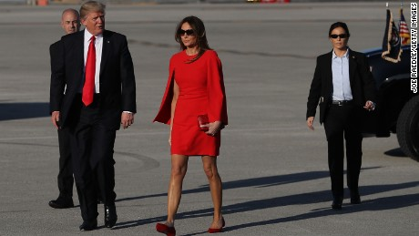 PALM BEACH, FL:  U.S. President Donald Trump  walks with his wife Melania Trump on the tarmac after he arrived on Air Force One at the Palm Beach International Airport for a visit to his Mar-a-Lago Resort for the weekend on February 3, 2017 in Palm Beach, Florida. (Joe Raedle/Getty Images)