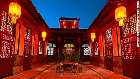 The courtyard at Xiang Sheng Yuan Guest House, pictured at night.