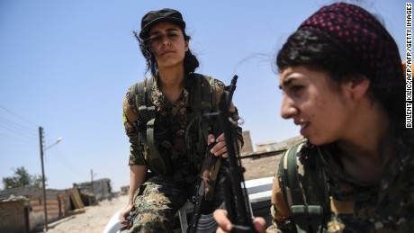 Female Kurdish fighters on the outskirts of Raqqa in July.