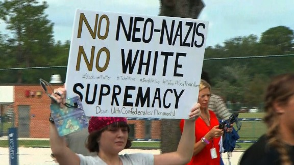Protesters held up signs against Richard Spencer in Gainesville.