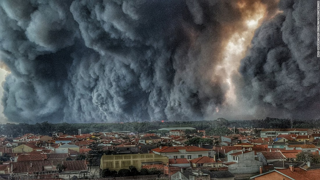"Fire and smoke are seen over the city of Vieira de Leiria, Portugal, on Monday, October 16, as a series of <a href=""http://www.cnn.com/2017/10/16/europe/portugal-spain-wildfires/index.html"" target=""_blank"">deadly wildfires</a> broke out across Spain and Portugal. With the approach of Hurricane Ophelia came strong winds that fanned the flames."