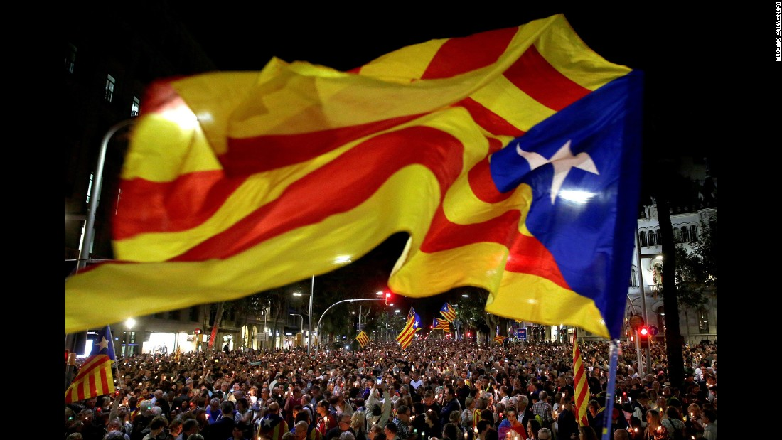 "Demonstrators take to the streets in downtown Barcelona on Tuesday, October 17, to protest actions against<a href=""http://www.cnn.com/2017/10/19/europe/catalonia-independence-spain-crisis/index.html"" target=""_blank""> separatist leaders</a> Jordi Sanchez and Jordi Cuixart, and head of the Catalan police force, Josep Lluís Trapero. Sanchez and Cuixart were taken into custody and Trapero's passport was confiscated."