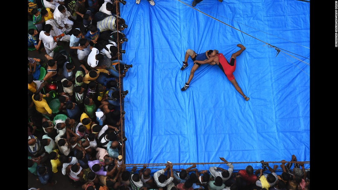 Indian amateur wrestlers participate in a friendly wrestling competition on a makeshift ring at the junction of a busy road on Wednesday, October 18. The bout was organized as part of Diwali festivities in Kolkata, India. Diwali, the Hindu festival of lights, marks the triumph of good over evil, and commemorates the return of Hindu deity Rama to his birthplace Ayodhya after victory against the demon king Ravana.