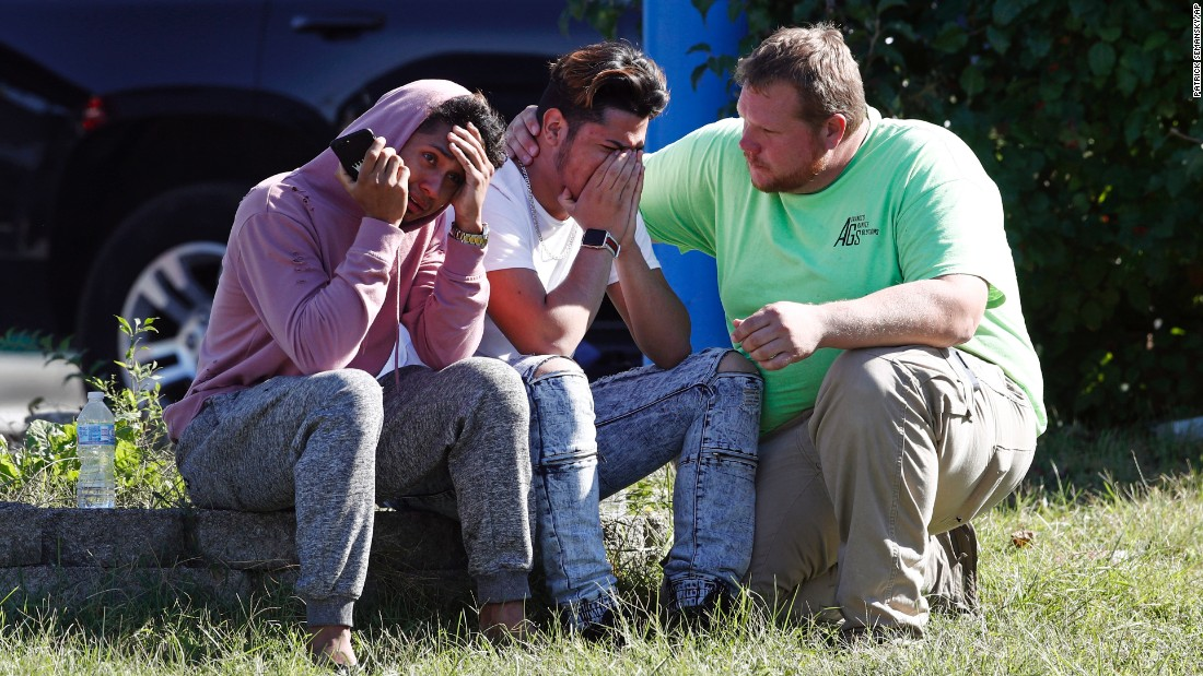 "People are consoled across the street from the scene of a <a href=""http://www.cnn.com/2017/10/18/us/maryland-harford-county-shooting/index.html"" target=""_blank"">shooting at a business park</a> in the Edgewood area of Harford County, Maryland, on Wednesday, October 18. Authorities said a man shot to death several co-workers and wounded others at Advanced Granite Solutions before fleeing the scene. He was later caught after a tip to authorities helped them find his vehicle."