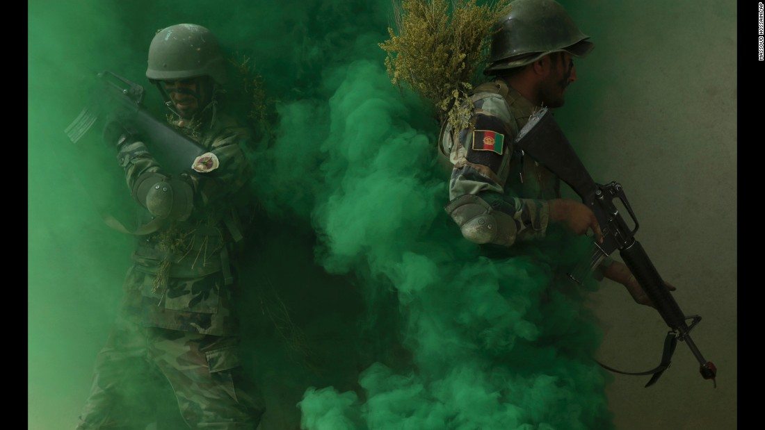 Afghan National Amy commandos take their position during a military exercise in Kabul, Afghanistan, on Tuesday, October 17.