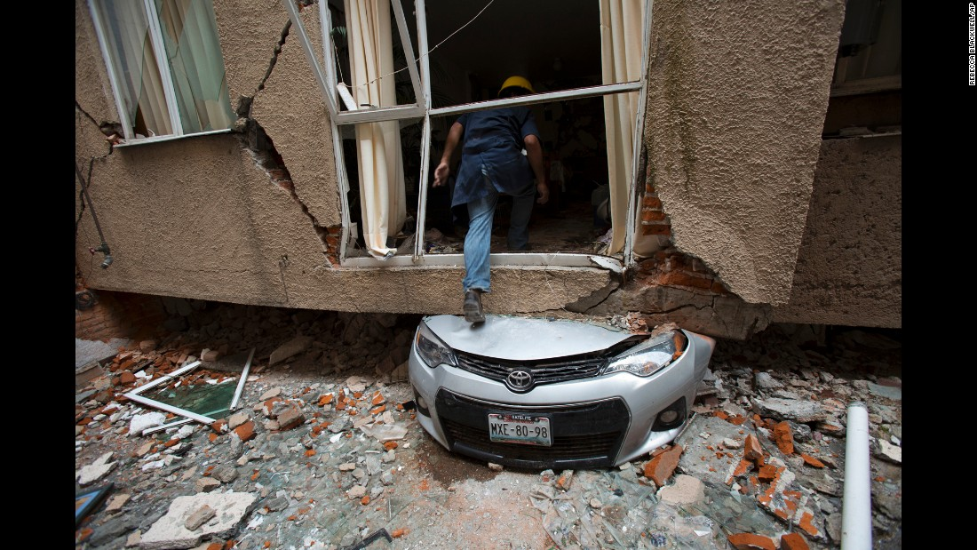 "Rodrigo Diaz Mejia climbs over a crushed car into what was a second-story apartment on Wednesday, October 18.  The Portales Norte neighborhood apartment was one of many destroyed by the <a href=""http://www.cnn.com/2017/09/19/americas/mexico-earthquake/index.html"" target=""_blank"">earthquake</a> that hit <a href=""http://www.cnn.com/2017/09/19/americas/gallery/mexico-earthquake-0919/index.html"" target=""_blank"">Mexico City</a> almost one month ago."