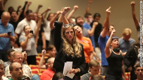 People react as Richard Spencer speaks at the Phillips Center on Thursday in Gainesville, Florida.