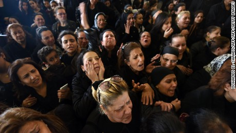 Women mourn for the victims of the blast at the Coptic Christian Saint Mark's church in Alexandria the previous day during a funeral procession at the Monastery of Marmina in the city of Borg El-Arab, east of Alexandria on April 10, 2017. Egypt prepared to impose a state of emergency after jihadist bombings killed dozens at two churches in the deadliest attacks in recent memory on the country's Coptic Christian minority. / AFP PHOTO / MOHAMED EL-SHAHED        (Photo credit should read MOHAMED EL-SHAHED/AFP/Getty Images)