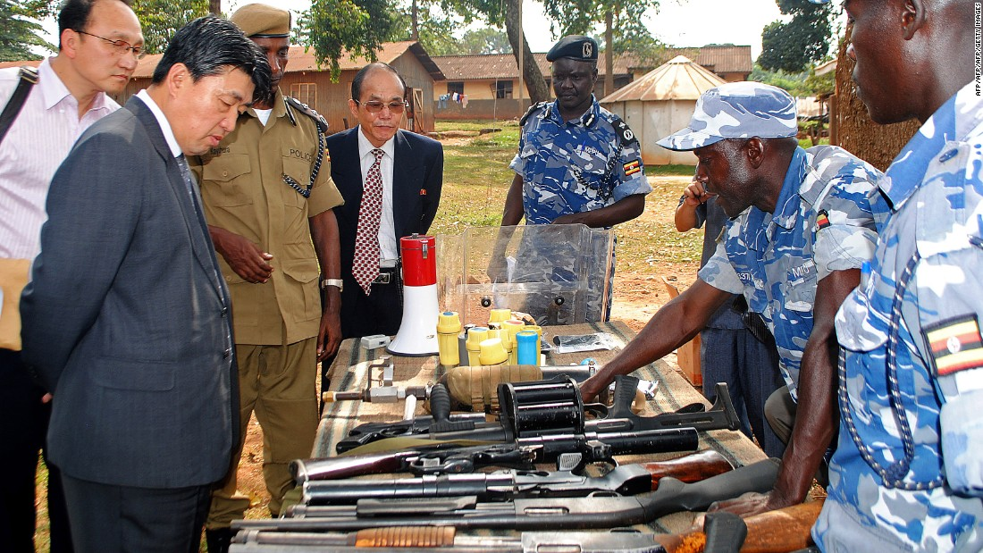 North Korean vice Minister of the the Ministry of Peoples Security, Mr. Ri Song Chol (second from the left) inspects weapons at a police training academy in Kampala, Uganda, in June 2013.