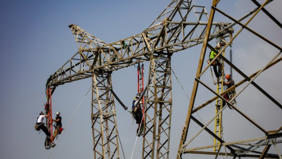 Linemen work to restore a key central transmission route.
