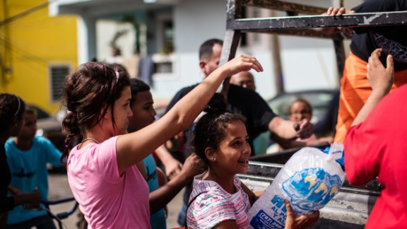 Without power for  freezers, residents of La Perla still rely on ice deliveries.