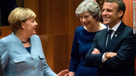 German Chancellor Angela Merkel, Britain Prime minister Theresa May and French President Emmanuel Macron talk as they arrive in Brussels.