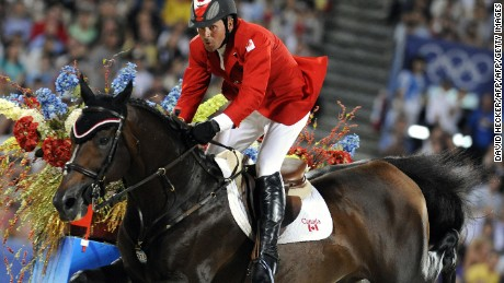 "Eric Lamaze of Canada rides with ""Hickstead"" in the equestrian jumping individual competition in Hong Kong on August 21, 2008 during the 2008 Beijing Olympic Games.       AFP PHOTO / DDP / DAVID HECKER  (Photo credit should read DAVID HECKER/AFP/Getty Images)"