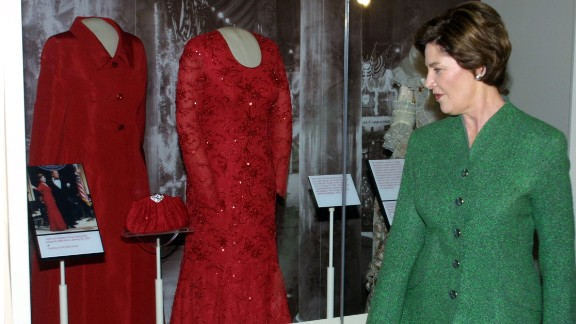First lady Laura Bush looks at her inaugural ball gown after it was set on display at the American history museum on January 20, 2002.