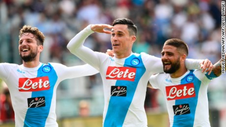 Napoli's Belgian striker Dries Mertens (L) and Napoli's Italian striker Lorenzo Insigne (R) congratulate Napoli's Spanish striker Jose Maria Callejon after scoring during the Italian Serie A football match Torino vs Napoli at the Olympic stadium in Turin, on May 14, 2017. / AFP PHOTO / MIGUEL MEDINA        (Photo credit should read MIGUEL MEDINA/AFP/Getty Images)