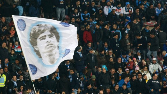 Fans of SSC Napoli wave a flag depicting former Napoli