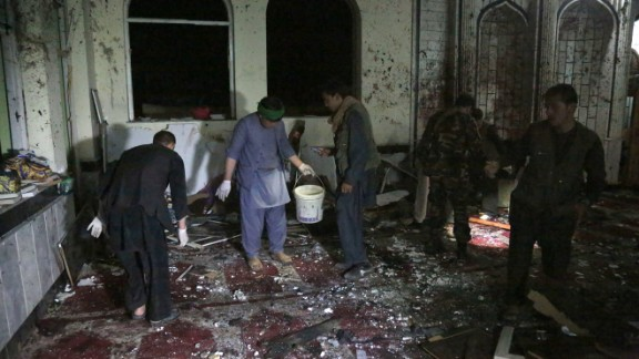 People inspect the site of an attack at a Shiite mosque in Kabul, capital of Afghanistan, on Oct. 20, 2017.