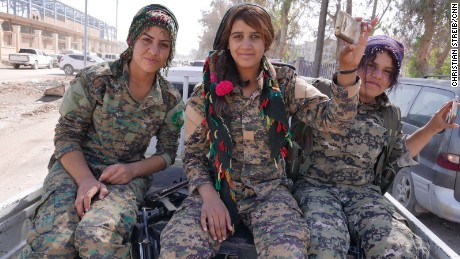Female Kurdish fighters head towards Raqqa stadium for celebrations after the defeat of ISIS.