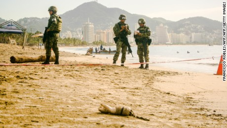 EDITORS NOTE: Graphic content / Mexican soldiers guard the crime scene where a human arm was found in the beach of Hornos, in the tourist city of Acapulco, Guerrero state, Mexico on October 3, 2017.  The city of Acapulco suffers a wave of violence attributed to the fight between drug cartels that intend to control the territory. / AFP PHOTO / FRANCISCO ROBLES        (Photo credit should read FRANCISCO ROBLES/AFP/Getty Images)
