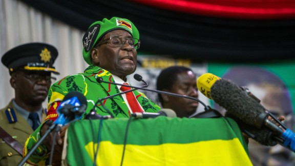 Zimbabwe's President Robert Mugabe delivers a speech during a meeting of his party's youth league where he hinted at a cabinet reshuffle, on October 7, 2017, in Harare. Robert Mugabe warned some ministers will be axed in a shake-up of his cabinet amid deepening infighting in his Zanu-PF party over who succeeds him. Mugabe's announcement came amid escalating tension between rival factions jostling to succeed the 93-year-old -- including his lieutenants and his wife. / AFP PHOTO / Jekesai NJIKIZANA        (Photo credit should read JEKESAI NJIKIZANA/AFP/Getty Images)