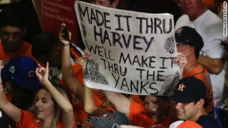 Fans celebrate after the Houston Astros beat the New York Yankees Saturday to go to the World Series.