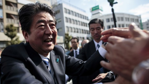 Japan's Prime Minister and ruling Liberal Democratic Party (LDP) president Shinzo Abe greets his supporters during an election campaign appearance in Saitama on October 18, 2017. / AFP PHOTO / Behrouz MEHRI        (Photo credit should read BEHROUZ MEHRI/AFP/Getty Images)