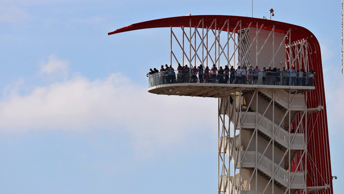 Spectators atop the observation tower at the Circuit of the Americas track.