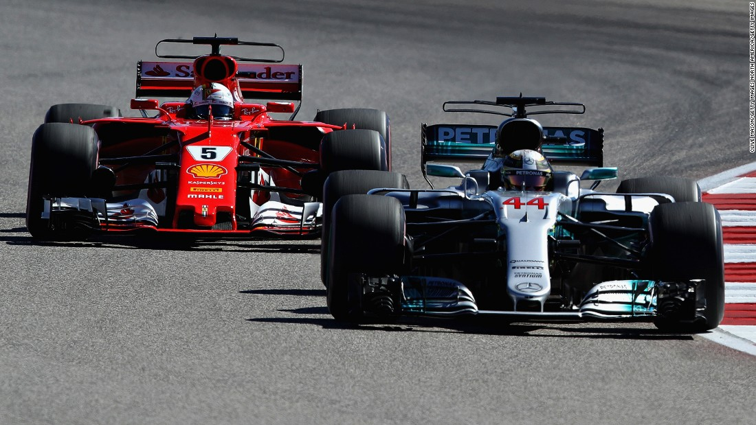 Lewis Hamilton (right) keeps Sebastian Vettel at bay during the United States Grand Prix at Austin.