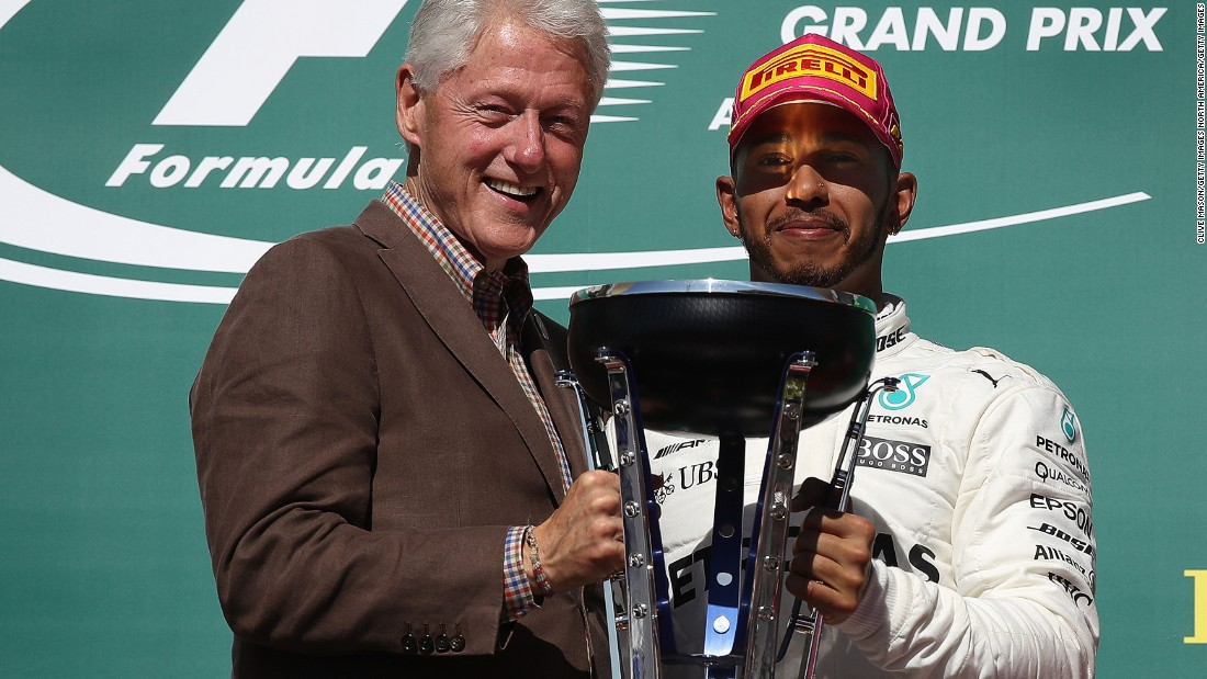 Former US President Bill Clinton presented Hamilton with his winner's trophy at the Circuit of the Americas.