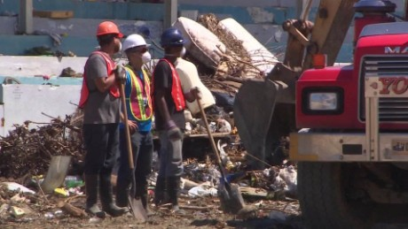 Workers help clean up debris in the aftermath of Hurricane Maria in Puerto Rico.