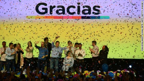 Argentina's President Mauricio Macri (C) celebrates with Argentina's Vice-President Gabriela Michetti (on wheel chair) Buenos Aires Governor Maria Eugenia Vidal (4-L) Buenos Aires Mayor Horacio Rodriguez Larreta (5-L) and ruling party elected candidates after the legislative elections in Argentina, in Buenos Aires on October 23, 2017.  Argentine President Maurico Macri's center-right coalition was ahead in mid-term elections Sunday, putting him on course to strengthen his hand to carry through pro-market economic reforms, partial results showed. / AFP PHOTO / MAXIMILIANO LUNA        (Photo credit should read MAXIMILIANO LUNA/AFP/Getty Images)